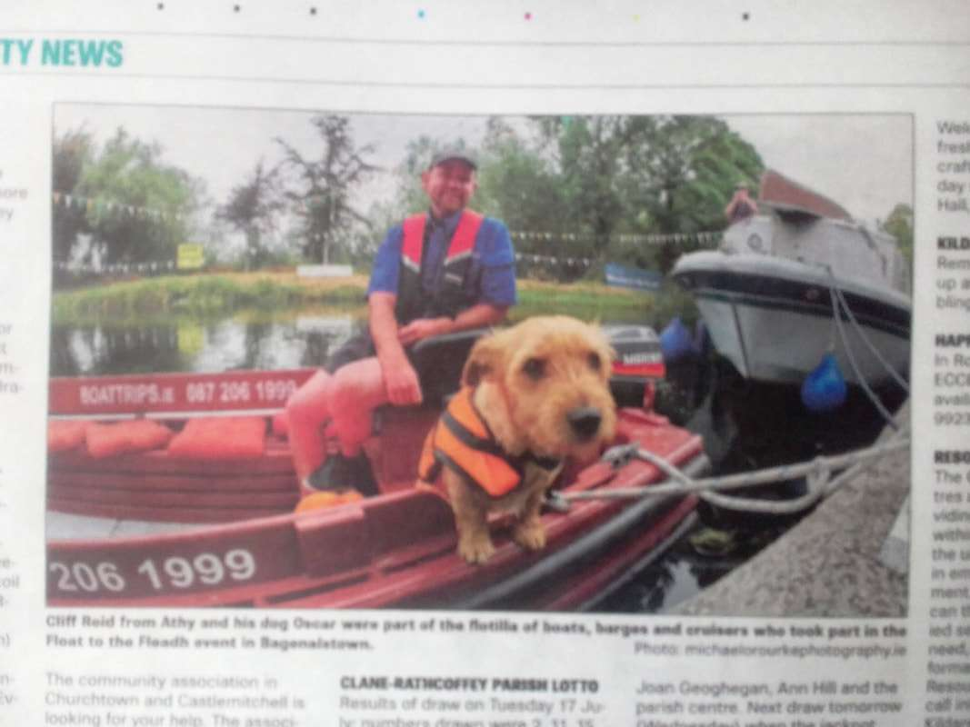Newpaper picture of a dog on a baot