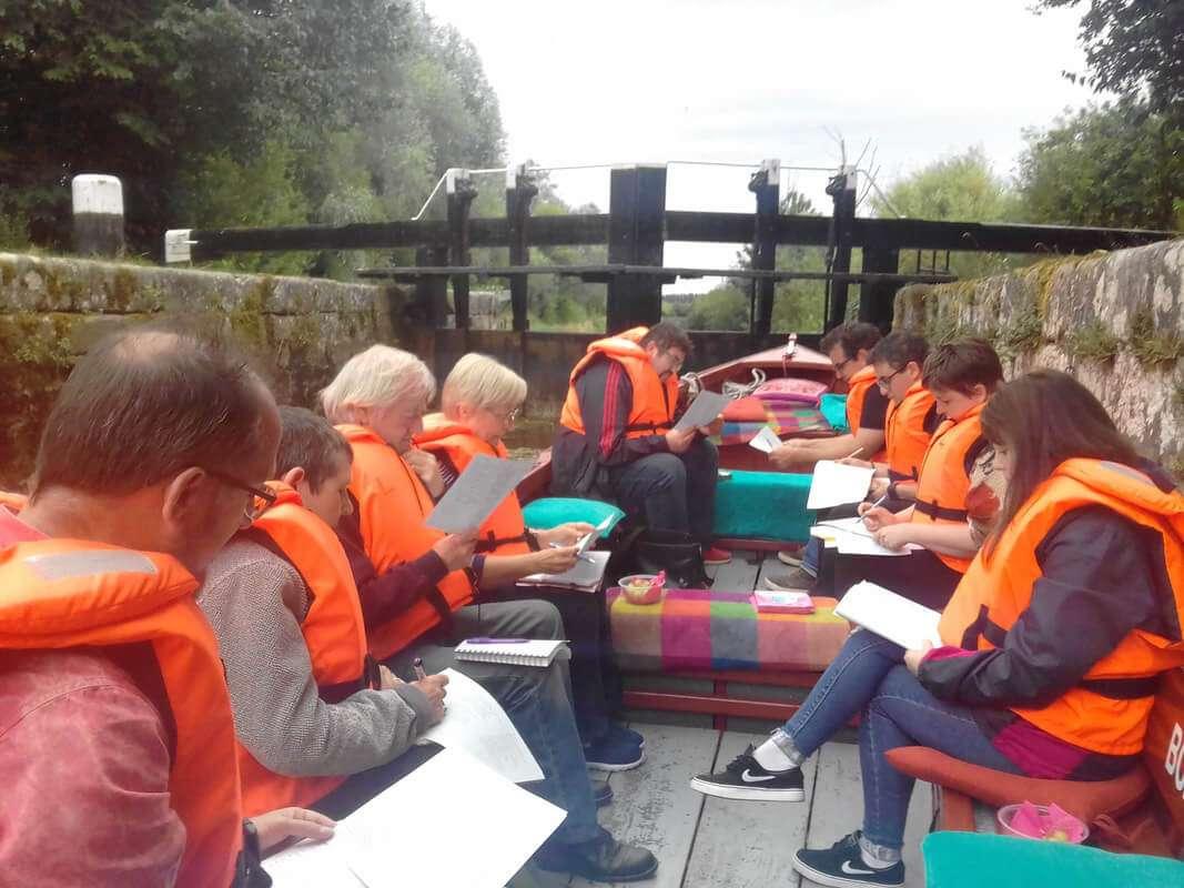 Boat Trip passengers studying poetry in bestfield lock