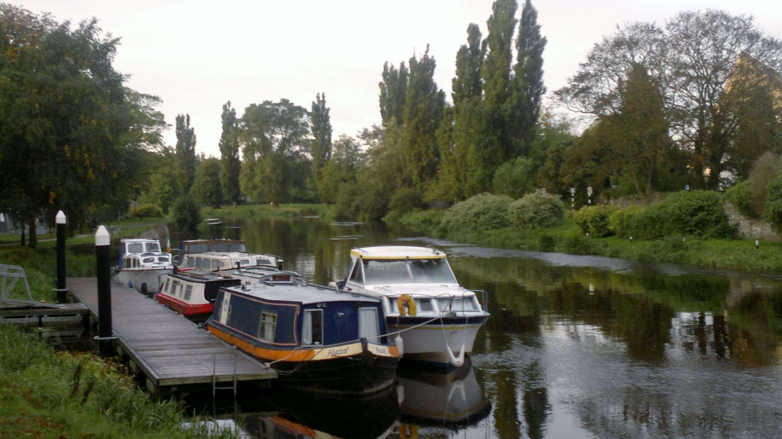Boats moored at a floating jetty in Athy