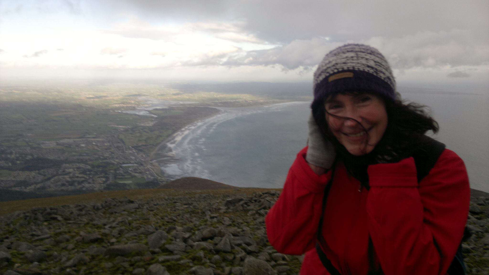 Ann Marie Dunne on mountain with county Down coastline in background