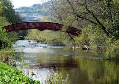Red footbridge over river Barrow at the Dolmen Hotel in Carlow