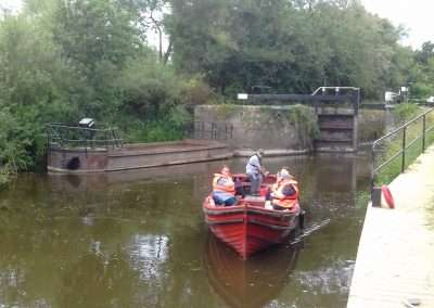 Trip Boat leaving Bestfield lock on river Barrow Navigation in Carlow