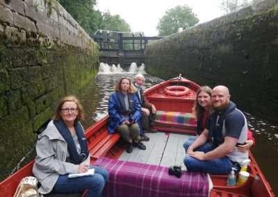 Passengers on trip boat inside Bestfield Lock, Carlow, Ireland