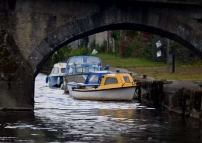 Moored boats under a arch of Leighlinbridge Town Bridge