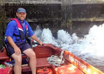 Skipper Clifford Reid on a trip boat inside Bestfield Lock