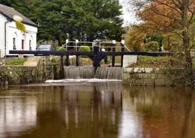 Water spilling over the lock gates at Clogrennan Lock on river Barrow in Carlow. A reselt of flooding on the Barrow