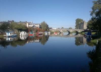 Cromaboo bridge and moored boats in Athy, county Kildare, Ireland