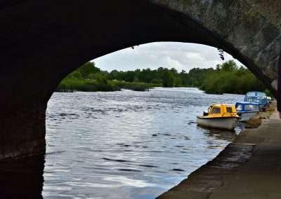 Small boats moored under bridge on river Barrow