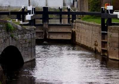 View of Carlow lock and disused mill race. Lock gates are open.