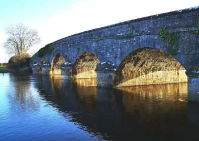 Side view of Dunrally Bridge on the river Barrow on a sunny winters morning