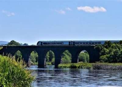 Train crossing Fenniscourt railway bridge over the river Barrow in Carlow, Ireland