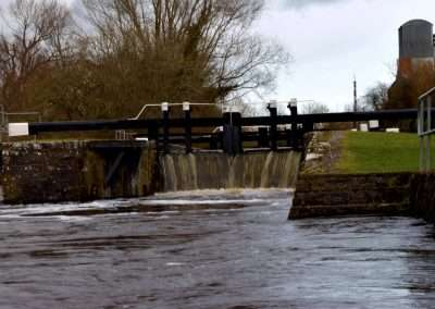 Water spilling over the Tail gates of Upper Ballyellen Lock on river Barrow. The river is in Flood.