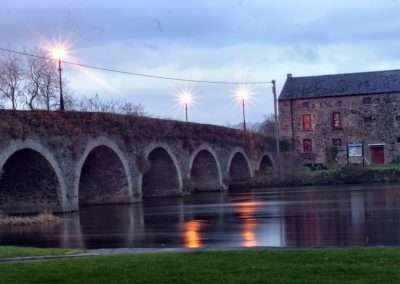 Bridge and malt stores on river Barrow at dusk in Goresbridge, Ireland