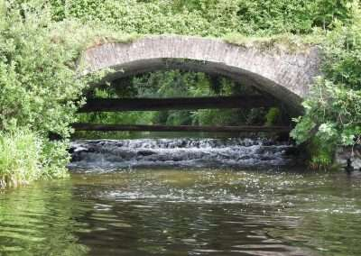 Mouth of the river Griese under a bridge entering river Barrow at Maganey, Kildare, Ireland