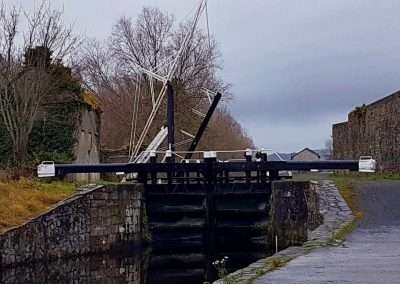 View of Muine Bheag Lockhouse, lifting bridge and lock from below the lock in Bagenalstown, Carlow, Ireland.