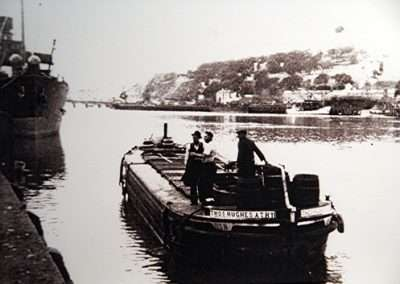 Men working on a Barge on river Barrow
