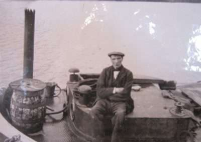 Workman sitting on a barge
