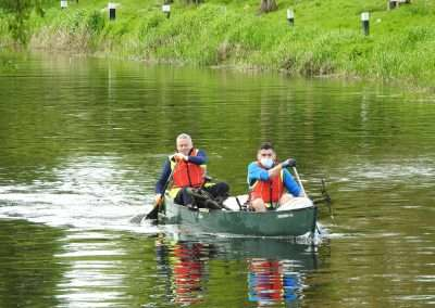 Volunteers in a canoe collecting rubbish on river Barrow in Athy