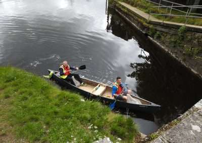 Councillor Brian Dooley and friend collecting litter in Canoe on the river Barrow in Athy, Kildare