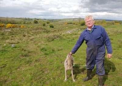 Farmer David Hasting and his dog, Pip, at the source of river Nore on his land at Gurteenashingaun