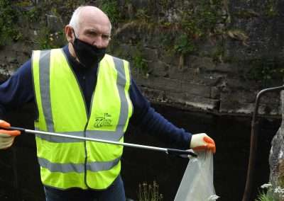 John Lynch doing a litter pick on the bank of the river Barrow in Athy, County Kildare, Ireland.